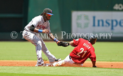 May 15, 2011; Houston, TX, USA; New York Mets infielder Jose Reyes (7) applies the tag as Houston Astros outfielder Michael Bourn (21) is caught stealing in the first inning at Minute Maid Park. Mandatory Credit: Troy Taormina-US PRESSWIRE