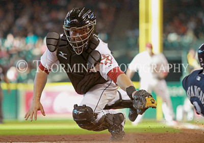 August 06, 2011; Houston, TX, USA; Houston Astros catcher Humberto Quintero (55) attempts to tag out a runner at the plate in the third inning of a game against the Milwaukee Brewers at Minute Maid Park. Mandatory Credit: Troy Taormina-US PRESSWIRE