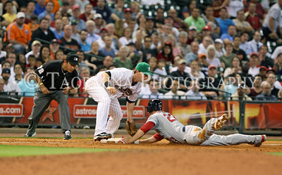 April 26, 2011; Houston, TX, USA; Houston Astros infielder Chris Johnson (23) applies the tag on St. Louis Cardinals third baseman David Freese (23) on an attempted sacrafice bunt at Minute Maid Park. The Astros defeated the Cardinals 6-5. Mandatory Credit: Troy Taormina-US PRESSWIRE