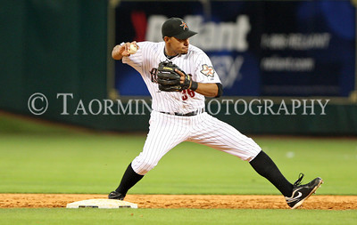 April 27, 2011; Houston, TX, USA; Houston Astros infielder Angel Sanchez (36) steps on second  base and throws to first in the ninth inning against the St. Louis Cardinals at Minute Maid Park. Mandatory Credit: Troy Taormina-US PRESSWIRE