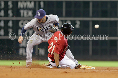 June 26, 2011; Houston, TX, USA; Houston Astros outfielder Michael Bourn (21) slides safely into second base as Tampa Bay Rays infielder Sean Rodriguez (1) is unable to field the throwin the fourth inning at Minute Maid Park. Mandatory Credit: Troy Taormina-US PRESSWIRE