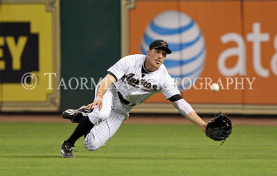 May 10, 2011; Houston, TX, USA; Houston Astros outfielder Hunter Pence (9) attempts a diving catch in the fifth inning against the Cincinnati Reds at Minute Maid Park. The Reds defeated the Astros 7-3. Mandatory Credit: Troy Taormina-US PRESSWIRE