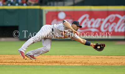 April 27, 2011; Houston, TX, USA; St. Louis Cardinals first baseman Albert Pujols (5) makes a diving catch in the third inning against the Houston Astros at Minute Maid Park. Mandatory Credit: Troy Taormina-US PRESSWIRE