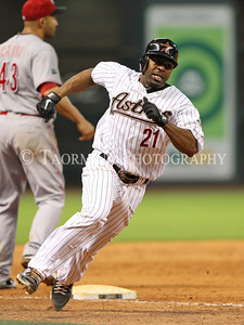 May 10, 2011; Houston, TX, USA;  Houston Astros outfielder Michael Bourn (21) races past Cincinnati Reds third baseman Miguel Cairo (43) to score a run in the eighth inning at Minute Maid Park. The Reds defeated the Astros 7-3. Mandatory Credit: Troy Taormina-US PRESSWIRE