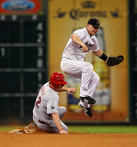 August 27, 2008 - Geoff Blum dodges a sliding Jay Bruce as he turns a double play in the 7th inning.  The Houston Astros defeated the Cincinnati Reds 4-1 at Minute Maid Park in Houston.