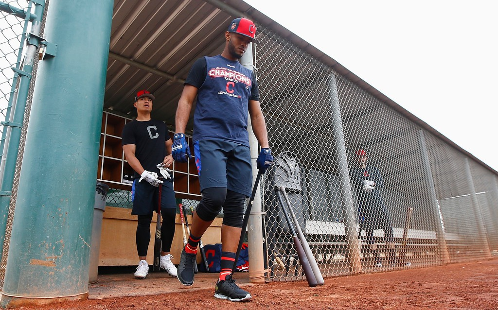. Cleveland Indians second baseman Willi Castro, right, and shortstop Yu-Cheng Chang, left, of Taiwan, arrive for batting practice at the Indians spring training facility Friday, Feb. 16, 2018, in Goodyear, Ariz. (AP Photo/Ross D. Franklin)