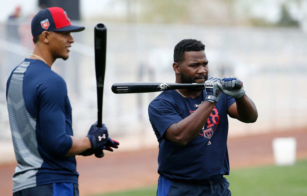 . Cleveland Indians right fielder Abraham Almonte, right, and second baseman Erik Gonzalez, left, wait their turn for batting practice at the Indians spring training facility Friday, Feb. 16, 2018, in Goodyear, Ariz. (AP Photo/Ross D. Franklin)