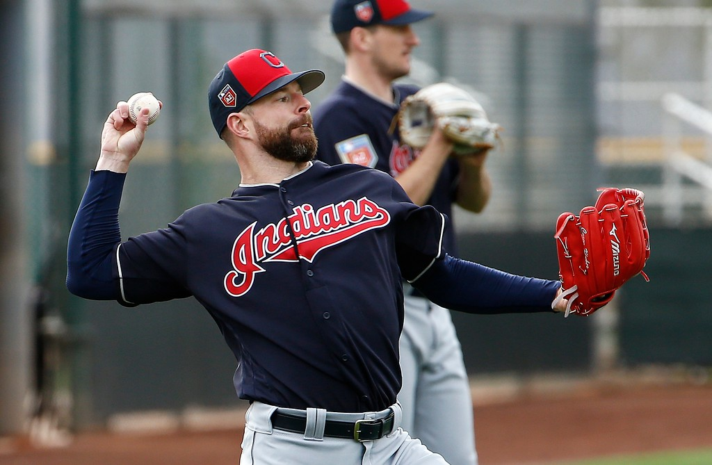 . Cleveland Indians starting pitcher Corey Kluber warms up with other pitchers at the Indians spring training facility Friday, Feb. 16, 2018, in Goodyear, Ariz. (AP Photo/Ross D. Franklin)