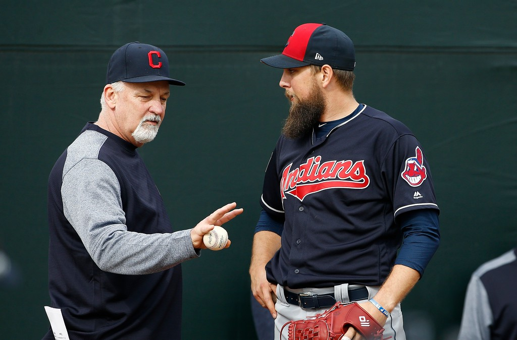 . Cleveland Indians pitching coach Carl Willis, left, talks with relief pitcher Josh Martin, right, during Martin\'s throwing session at the Indians spring training facility Friday, Feb. 16, 2018, in Goodyear, Ariz. (AP Photo/Ross D. Franklin)