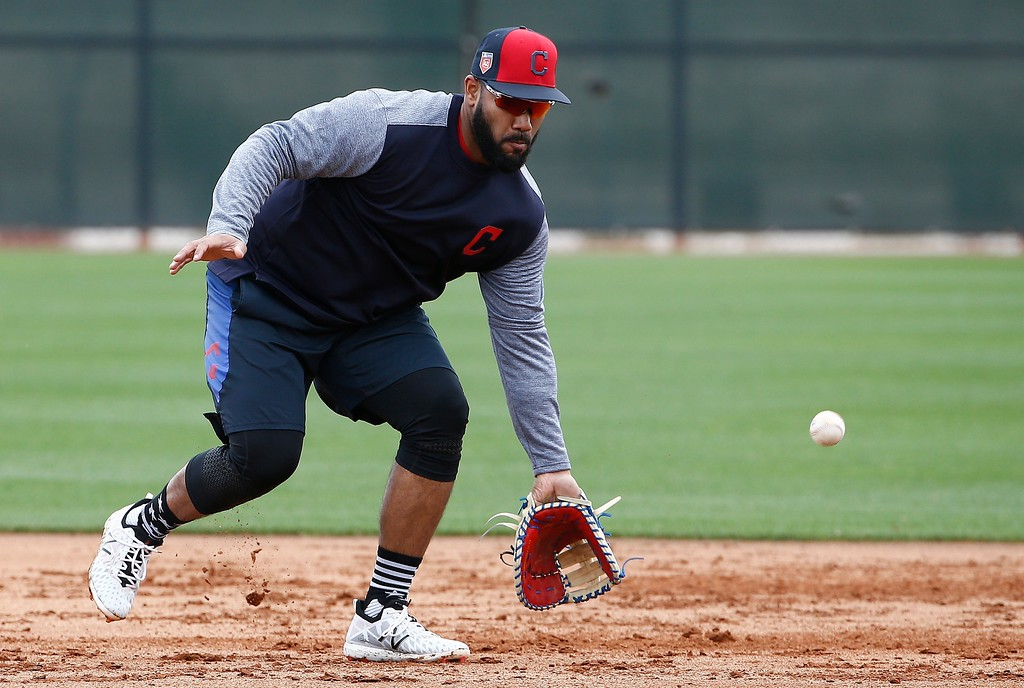 . Cleveland Indians first baseman Nellie Rodriguez fields a grounder at the Indians spring training facility Friday, Feb. 16, 2018, in Goodyear, Ariz. (AP Photo/Ross D. Franklin)
