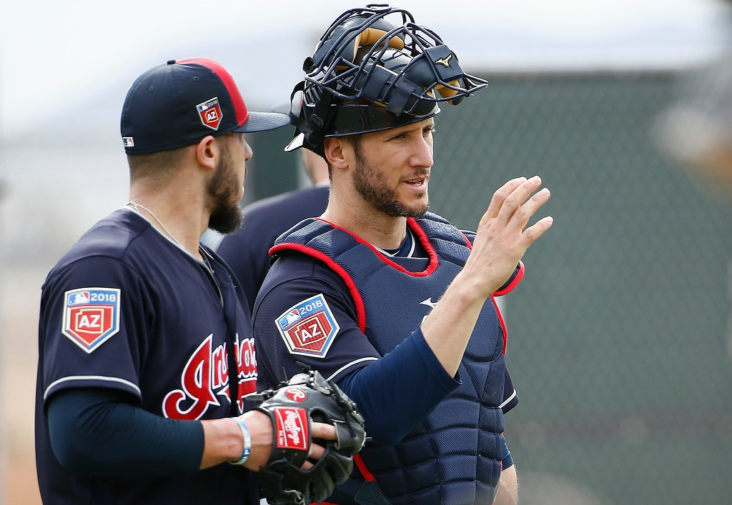 . Cleveland Indians catcher Yan Gomes, right, talks with relief pitcher Shawn Morimando after their throwing session at the Indians spring training facility Friday, Feb. 16, 2018, in Goodyear, Ariz. (AP Photo/Ross D. Franklin)