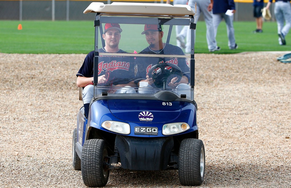 . Cleveland Indians starting pitchers Trevor Bauer, left, and Carlos Carrasco take a spin in a golf cart at the Indians spring training facility Friday, Feb. 16, 2018, in Goodyear, Ariz. (AP Photo/Ross D. Franklin)