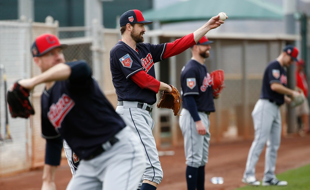 . Cleveland Indians relief pitcher Andrew Miller warms up with other pitchers at the Indians spring training facility Friday, Feb. 16, 2018, in Goodyear, Ariz. (AP Photo/Ross D. Franklin)