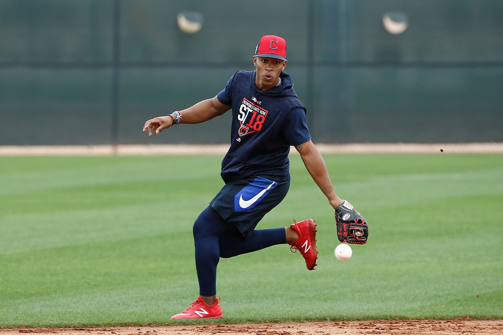 . Cleveland Indians shortstop Francisco Lindor chases down a grounder at the Indians spring training facility Friday, Feb. 16, 2018, in Goodyear, Ariz. (AP Photo/Ross D. Franklin)