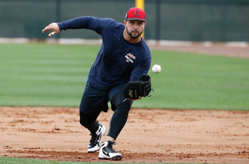 . Cleveland Indians first baseman Yonder Alonso gets ready to field a grounder at the Indians spring training facility Friday, Feb. 16, 2018, in Goodyear, Ariz. (AP Photo/Ross D. Franklin)
