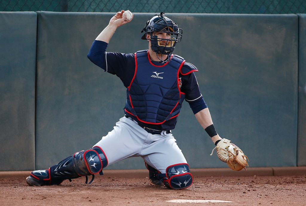 . Cleveland Indians catcher Yan Gomes throws the baseball back to a pitcher at the Indians spring training facility Friday, Feb. 16, 2018, in Goodyear, Ariz. (AP Photo/Ross D. Franklin)