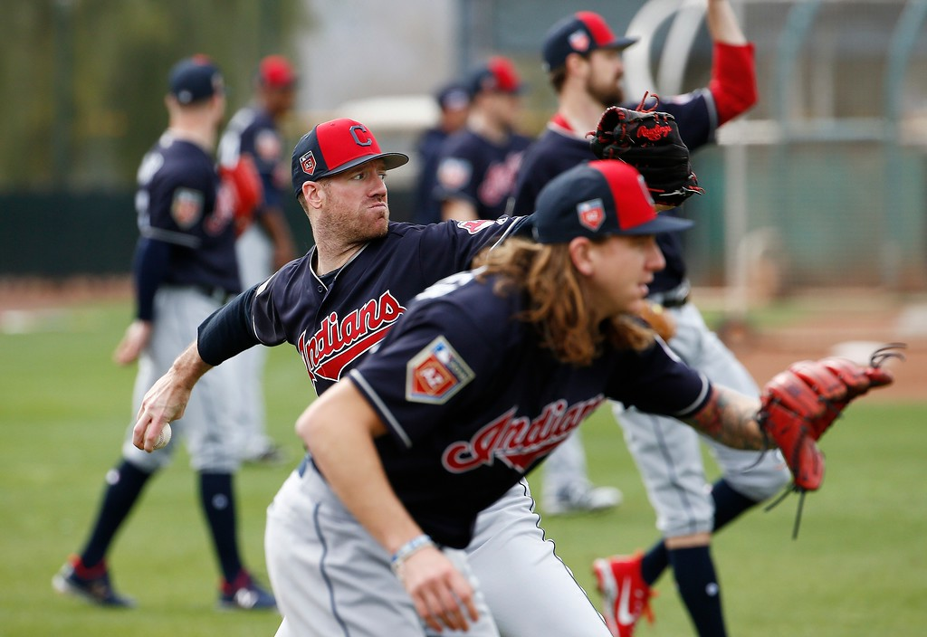 . Cleveland Indians relief pitcher Zach McAllister, left, and starting pitcher Mike Clevinger, right, warm up at the team\'s spring training facility Friday, Feb. 16, 2018, in Goodyear, Ariz. (AP Photo/Ross D. Franklin)