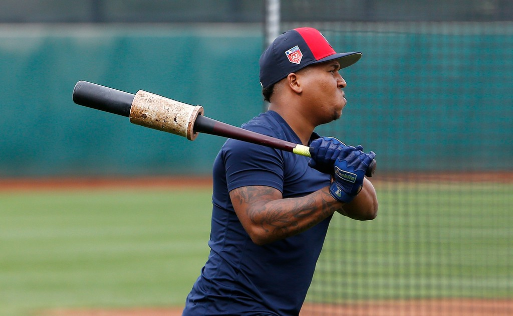 . Cleveland Indians third baseman Jose Ramirez warms up before taking batting practice at the Indians spring training facility Friday, Feb. 16, 2018, in Goodyear, Ariz. (AP Photo/Ross D. Franklin)
