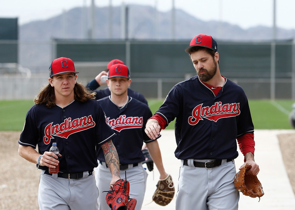 . Cleveland Indians relief pitcher Andrew Miller, right, talks with starting pitcher Mike Clevinger, left, as relief pitcher Cameron Hill, middle, walks behind them at the Indians spring training facility Friday, Feb. 16, 2018, in Goodyear, Ariz. (AP Photo/Ross D. Franklin)