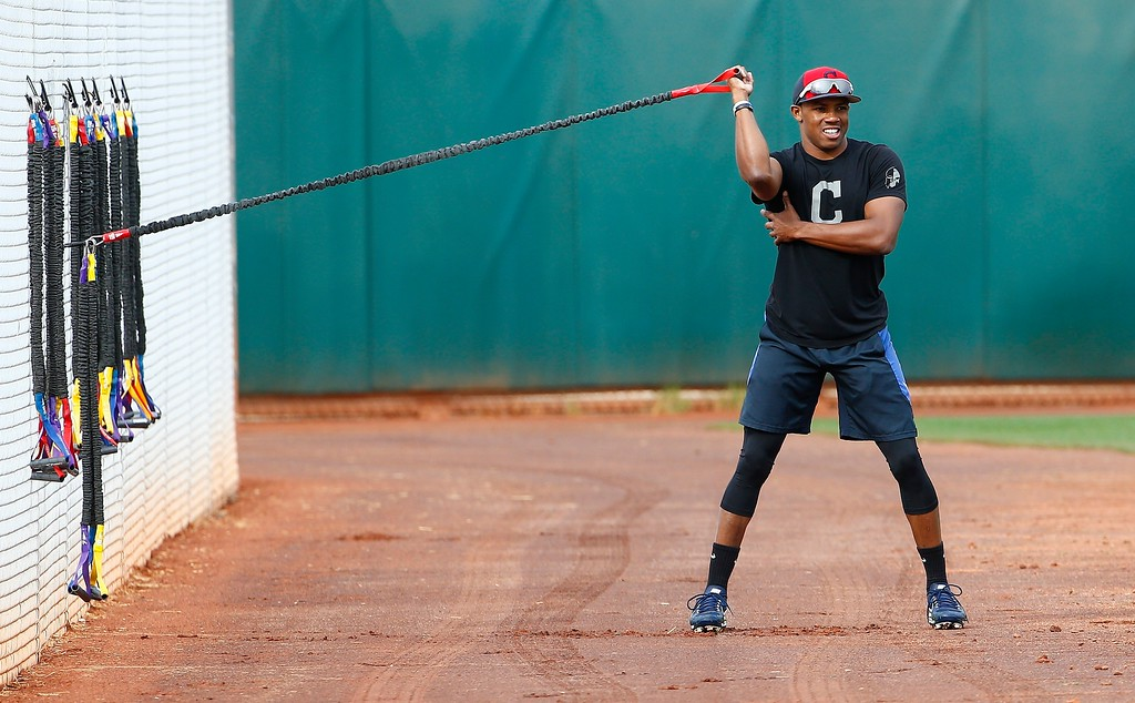 . Cleveland Indians center fielder Greg Allen stretches out at the Indians spring training facility Friday, Feb. 16, 2018, in Goodyear, Ariz. (AP Photo/Ross D. Franklin)