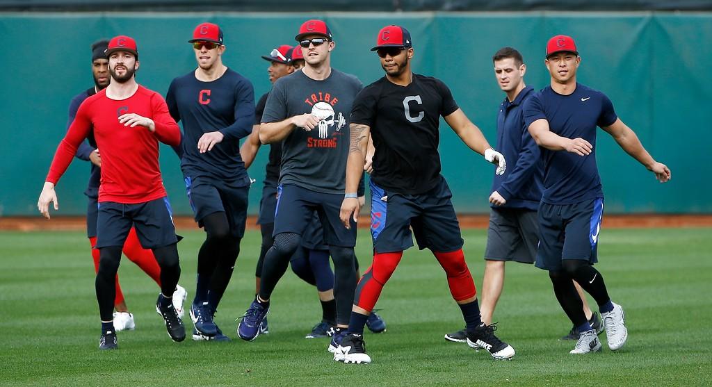 . Cleveland Indians position players warm up at the Indians spring training facility Friday, Feb. 16, 2018, in Goodyear, Ariz. (AP Photo/Ross D. Franklin)