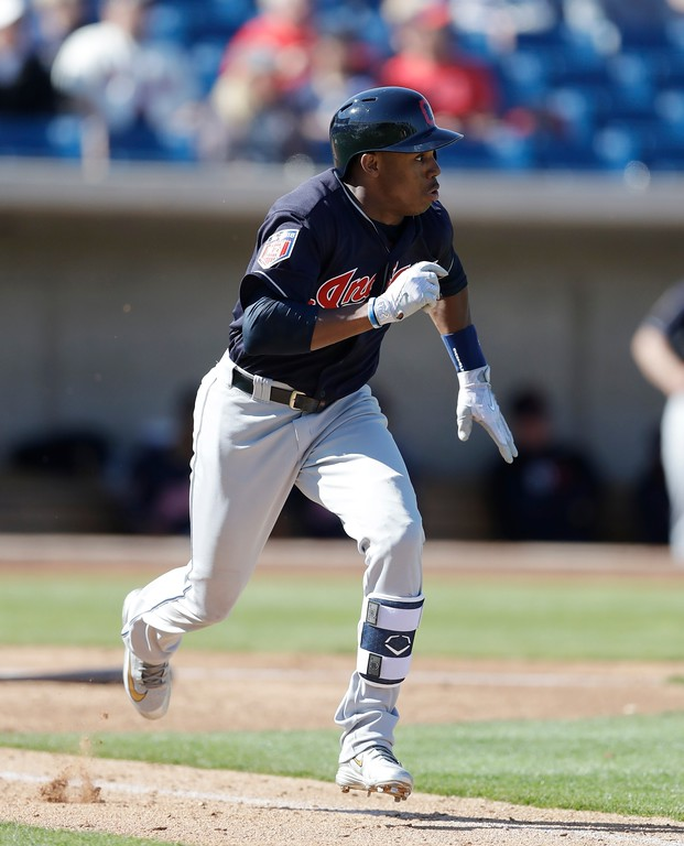 . Cleveland Indians\' Greg Allen runs to first during a spring training baseball game against the Milwaukee Brewers, Monday, Feb. 26, 2018, in Maryvale, Ariz. (AP Photo/Carlos Osorio)