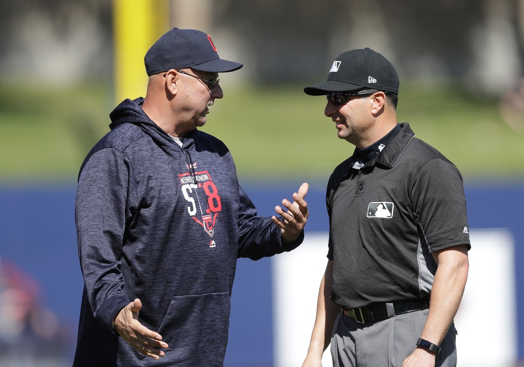 . Cleveland Indians manager Terry Francona talks with umpire Jim Reynolds before a spring training baseball game against the Milwaukee Brewers, Monday, Feb. 26, 2018, in Maryvale, Ariz. (AP Photo/Carlos Osorio)