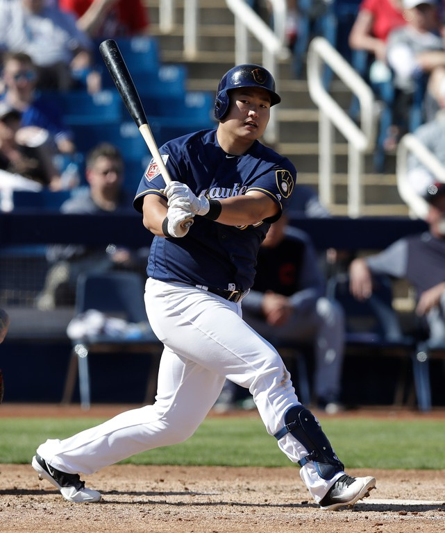 . Milwaukee Brewers\' Ji-Man Choi bats during a spring training baseball game against the Cleveland Indians, Monday, Feb. 26, 2018, in Maryvale, Ariz. (AP Photo/Carlos Osorio)