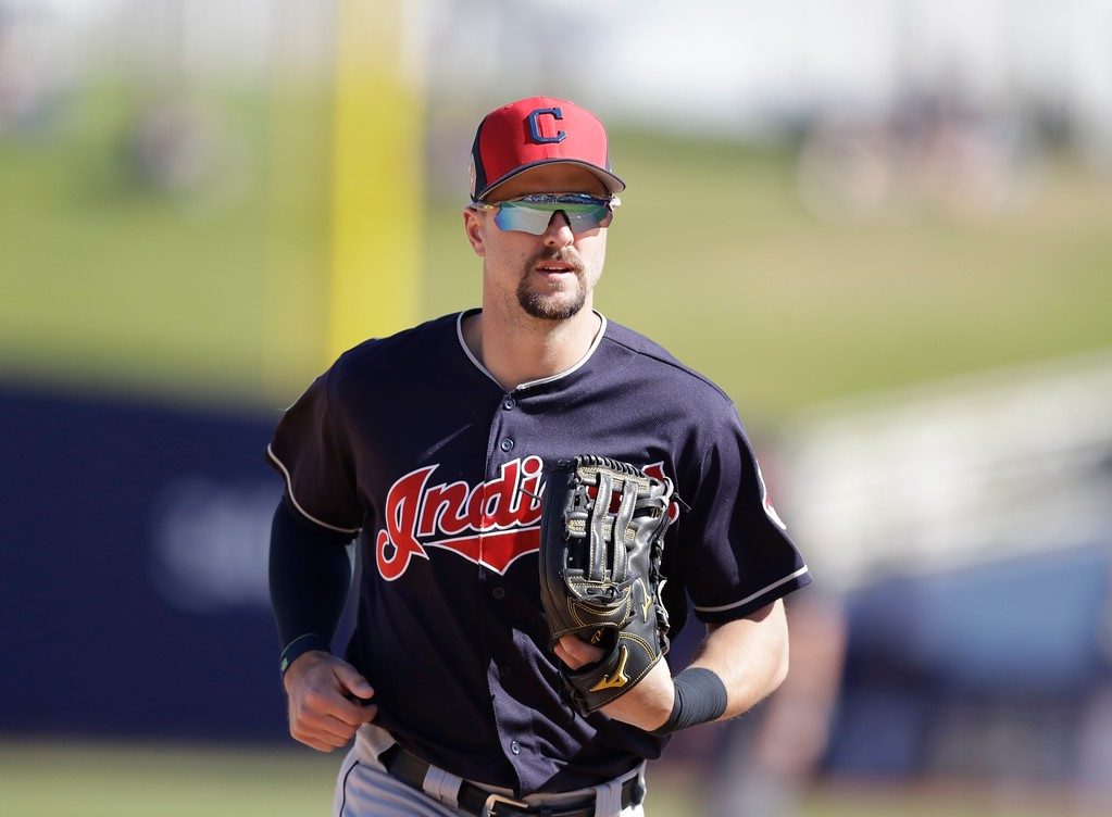 . Cleveland Indians outfielder Lonnie Chisenhall runs to the dugout during a spring training baseball game against the Milwaukee Brewers, Monday, Feb. 26, 2018, in Maryvale, Ariz. (AP Photo/Carlos Osorio)