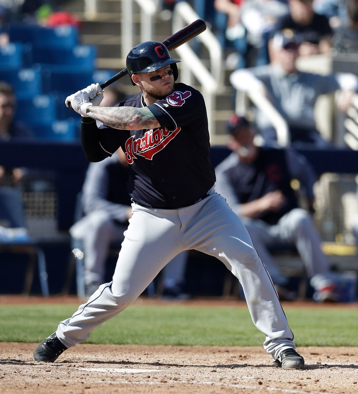 . Cleveland Indians\' Roberto Perez bats during a spring training baseball game against the Milwaukee Brewers, Monday, Feb. 26, 2018, in Maryvale, Ariz. (AP Photo/Carlos Osorio)