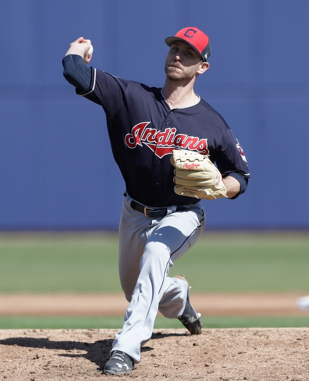 . Cleveland Indians pitcher Josh Tomlin throws during the first inning of a spring training baseball game against the Milwaukee Brewers, Monday, Feb. 26, 2018, in Maryvale, Ariz. (AP Photo/Carlos Osorio)