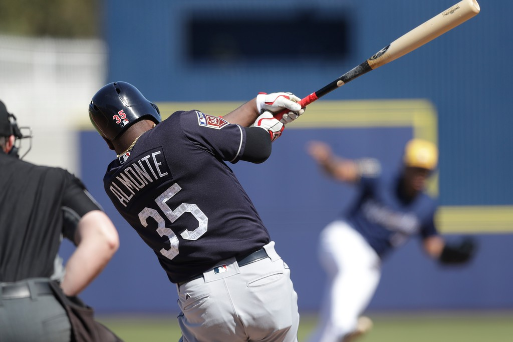 . Cleveland Indians\' Abraham Almonte bats during a spring training baseball game against the Milwaukee Brewers, Monday, Feb. 26, 2018, in Maryvale, Ariz. (AP Photo/Carlos Osorio)