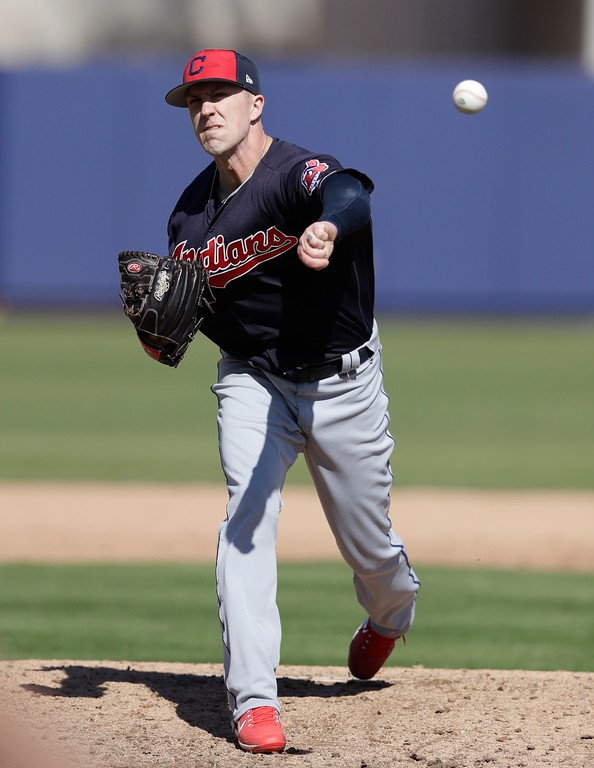 . Cleveland Indians pitcher Tyler Olson throws during a spring training baseball game against the Milwaukee Brewers, Monday, Feb. 26, 2018, in Maryvale, Ariz. (AP Photo/Carlos Osorio)