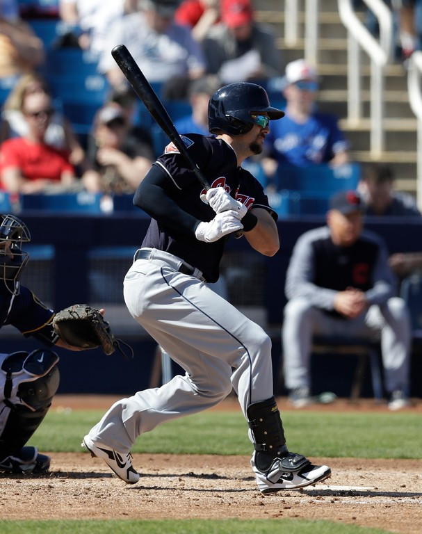 . Cleveland Indians outfielder Lonnie Chisenhall bats during the fifth inning of a spring training baseball game against the Milwaukee Brewers, Monday, Feb. 26, 2018, in Maryvale, Ariz. (AP Photo/Carlos Osorio)