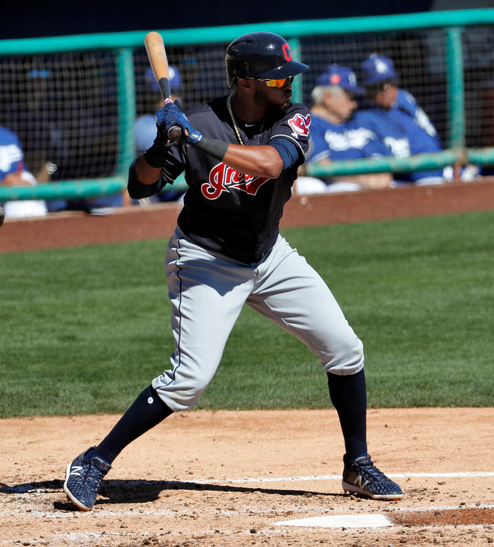 . Cleveland Indians\' Willi Castro hits against the Los Angeles Dodgers during the second inning of a spring training baseball game Monday, March 5, 2018, in Phoenix. (AP Photo/Matt York)