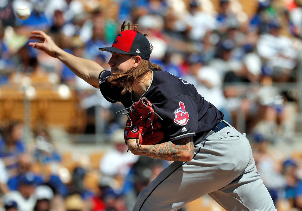 . Cleveland Indians pitcher Mike Clevinger throws against the Los Angeles Dodgers during the first inning of a spring training baseball game Monday, March 5, 2018, in Phoenix. (AP Photo/Matt York)