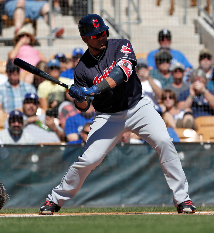 . Cleveland Indians\' Edwin Encarnacion hits during the first inning of a spring training baseball game against the Los Angeles Dodgers, Monday, March 5, 2018, in Phoenix. (AP Photo/Matt York)