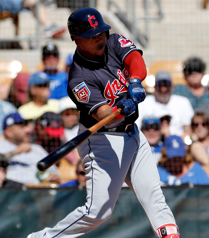 . Cleveland Indians\' Jose Ramirez hits during the first inning of a spring training baseball game against the Los Angeles Dodgers, Monday, March 5, 2018, in Phoenix. (AP Photo/Matt York)
