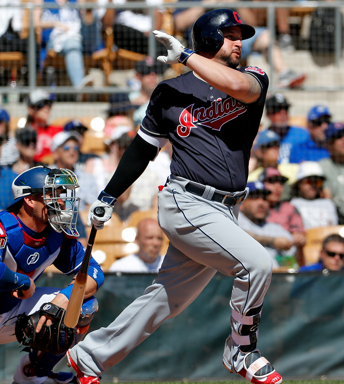 . Cleveland Indians\' Yonder Alonso follows through on an RBI-base hit during the first inning of a spring training baseball game against the Los Angeles Dodgers, Monday, March 5, 2018, in Phoenix. (AP Photo/Matt York)
