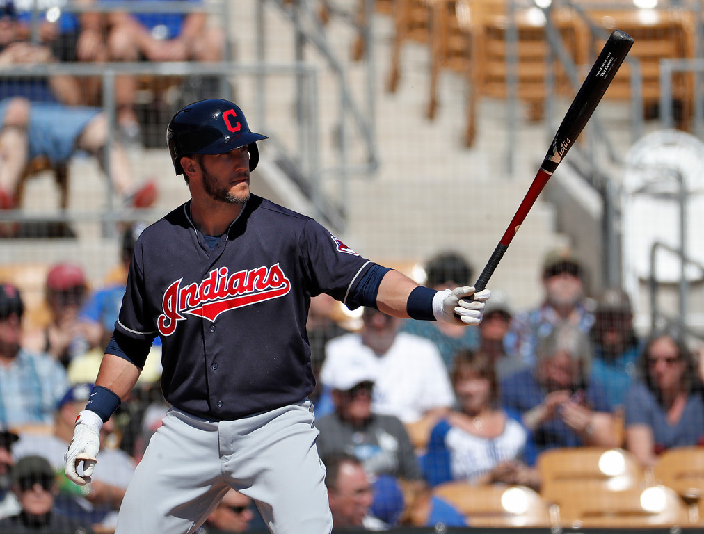 . Cleveland Indians\' Yan Gomes hits during the first inning of a spring training baseball game against the Los Angeles Dodgers, Monday, March 5, 2018, in Phoenix. (AP Photo/Matt York)
