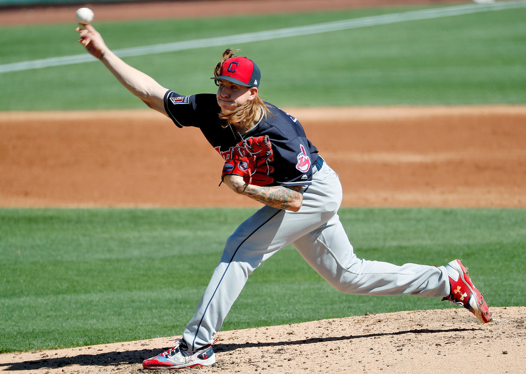 . Cleveland Indians pitcher Mike Clevinger throws against the Los Angeles Dodgers during the second inning of a spring training baseball game Monday, March 5, 2018, in Phoenix. (AP Photo/Matt York)