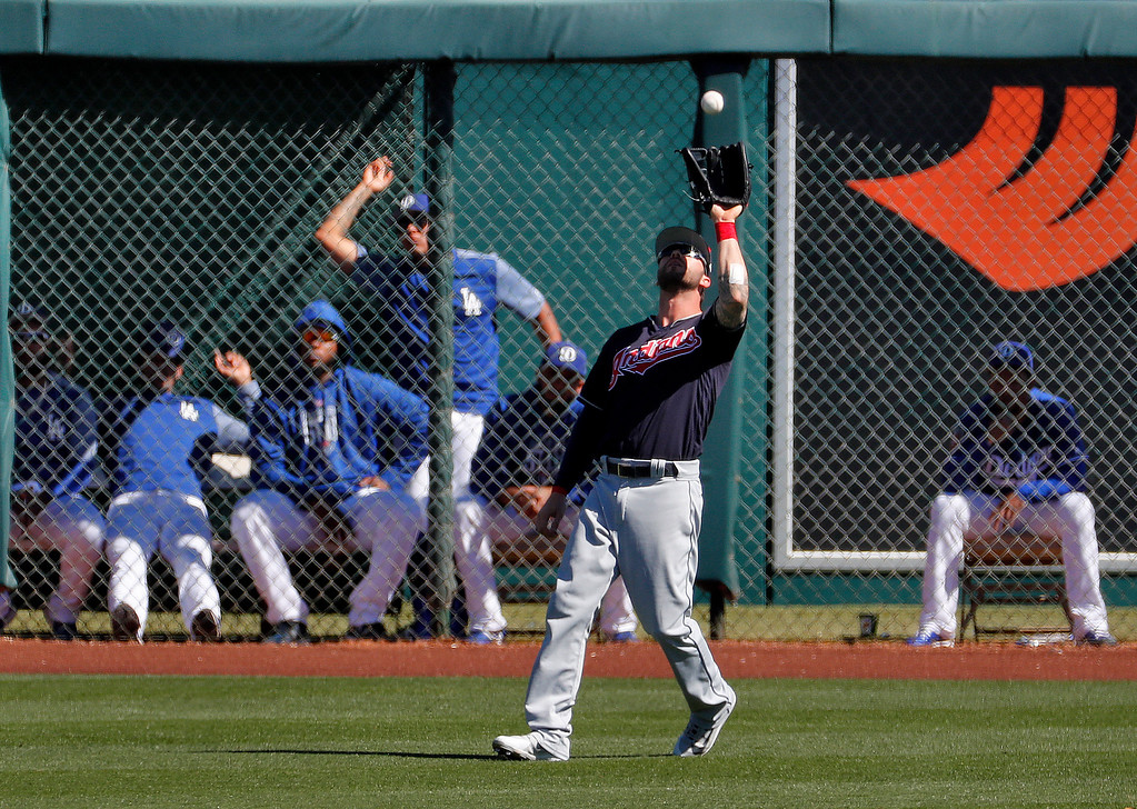 . Cleveland Indians\' Tyler Naquin fields a fly-out hit by Los Angeles Dodgers\' Kike Hernandez during the third inning of a spring training baseball game Monday, March 5, 2018, in Phoenix. (AP Photo/Matt York)