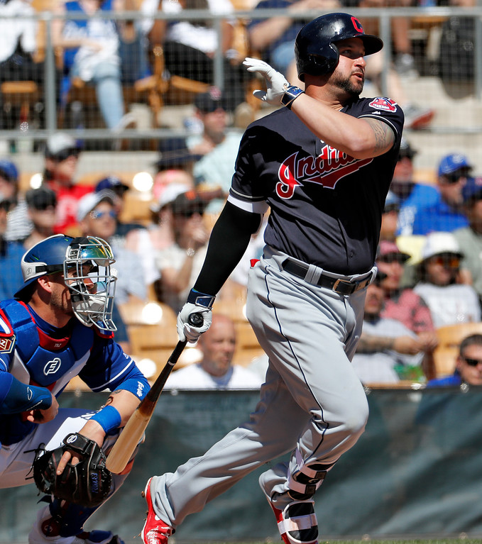 . Cleveland Indians\' Yonder Alonso follows through on an RBI base hit during the first inning of a spring training baseball game against the Los Angeles Dodgers, Monday, March 5, 2018, in Phoenix. (AP Photo/Matt York)
