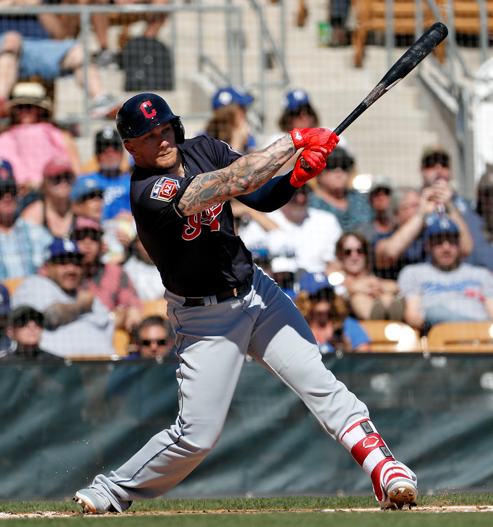 . Cleveland Indians\' Brandon Barnes hits during the second inning of a spring training baseball game against the Los Angeles Dodgers, Monday, March 5, 2018, in Phoenix. (AP Photo/Matt York)