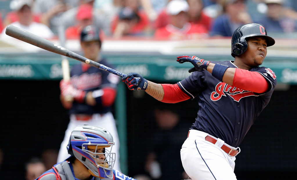 . Cleveland Indians\' Jose Ramirez hits a double off Texas Rangers starting pitcher Andrew Cashner in the sixth inning of a baseball game, Thursday, June 29, 2017, in Cleveland. (AP Photo/Tony Dejak)