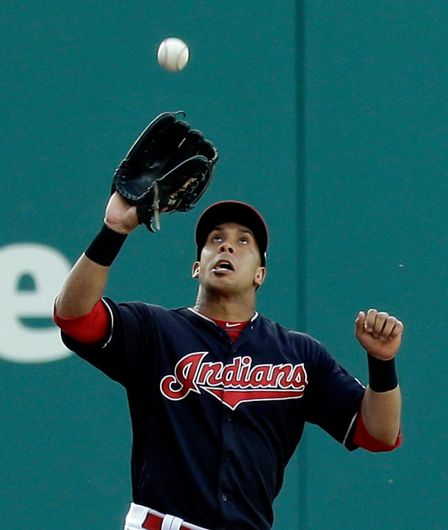 . Cleveland Indians\' Michael Brantley catches a ball hit by Kansas City Royals\' Mike Moustakas in the first inning of a baseball game, Friday, May 26, 2017, in Cleveland. Moustakas was out on the play. (AP Photo/Tony Dejak)