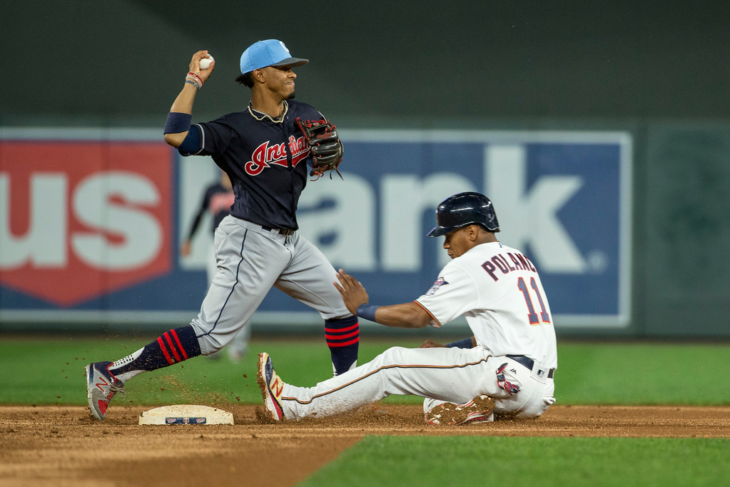 . Cleveland Indians shortstop Francisco Lindor forces out Minnesota Twins Jorge Polanco and turns a double play during the fifth inning of the second baseball game of a doubleheader Saturday, June 17, 2017, in Minneapolis. The Indians won 6-2. (AP Photo/Bruce Kluckhohn)
