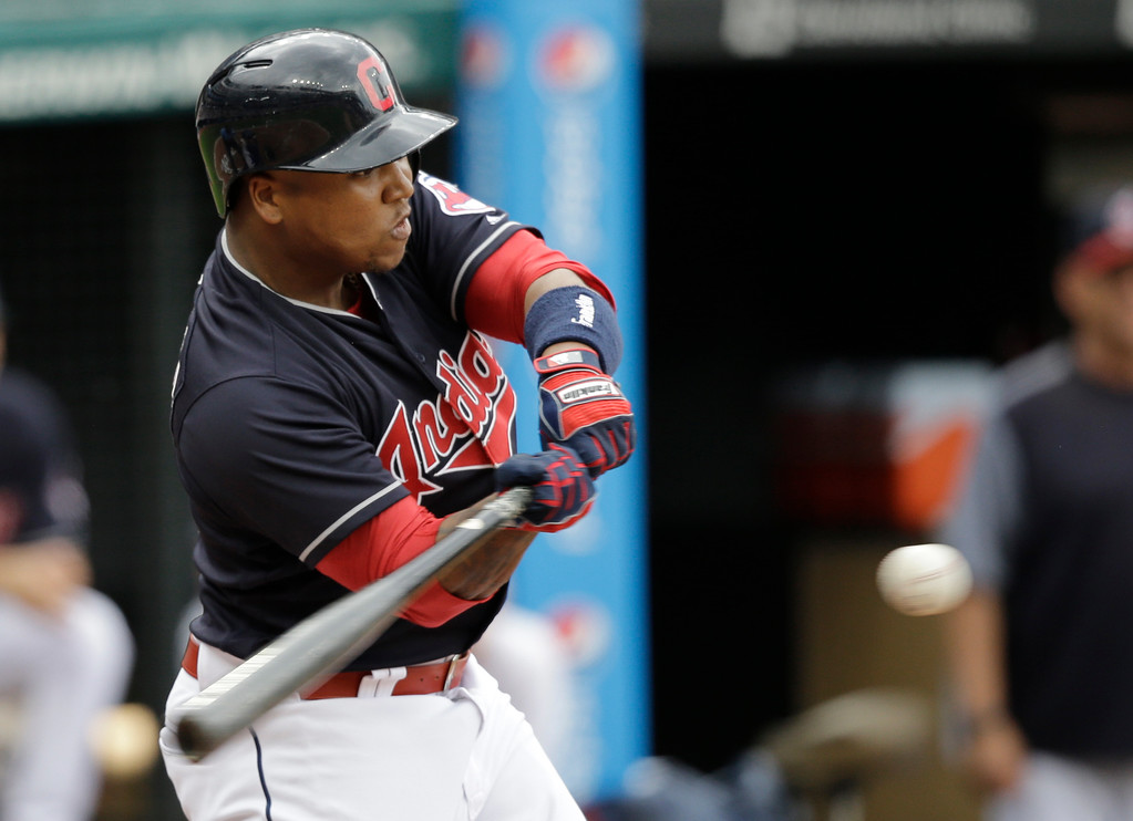 . Cleveland Indians\' Jose Ramirez hits an RBI-single off Los Angeles Dodgers starting pitcher Rich Hill in the first inning of a baseball game, Thursday, June 15, 2017, in Cleveland. Francisco Lindor scored on the play. (AP Photo/Tony Dejak)