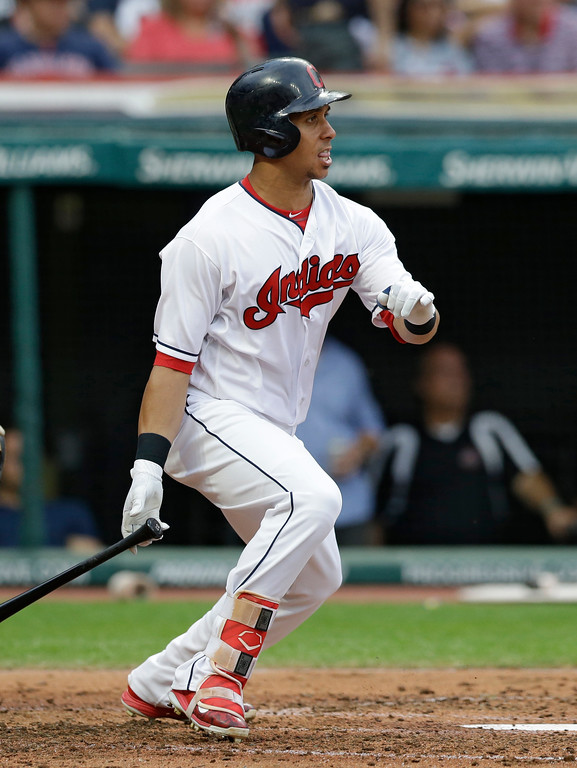 . Cleveland Indians\' Michael Brantley hits an RBI-single off Texas Rangers starting pitcher Yu Darvish in the third inning of a baseball game, Wednesday, June 28, 2017, in Cleveland. Jason Kipnis scored on the play. (AP Photo/Tony Dejak)