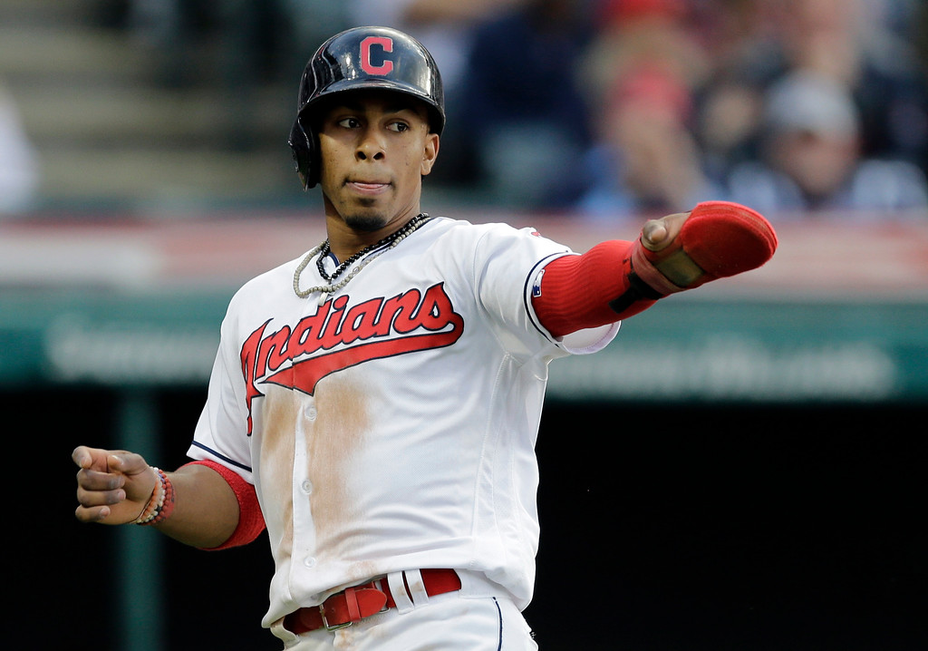. Cleveland Indians\' Francisco Lindor points toward first base at Michael Brantley after Lindor scored on Brantley\'s RBI-single in the fifth inning of a baseball game against the Oakland Athletics, Tuesday, May 30, 2017, in Cleveland. (AP Photo/Tony Dejak)